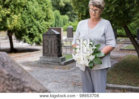 Mature Woman On Cemetery
