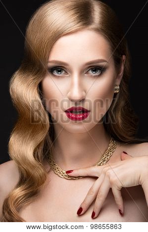 Beautiful woman with evening make-up, red lips and curls. Beauty face.