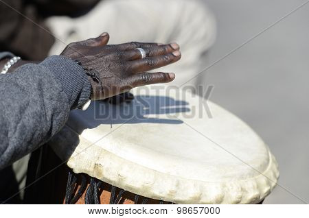 Hands Of Musician Playing The Tomtoms
