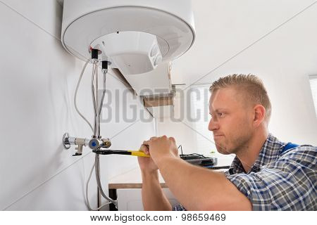 Repairman Repairing Electric Boiler