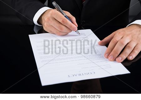 Businessperson Signing Contract Paper