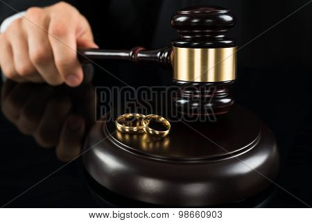 Close-up Of Judge Hitting Gavel With Rings