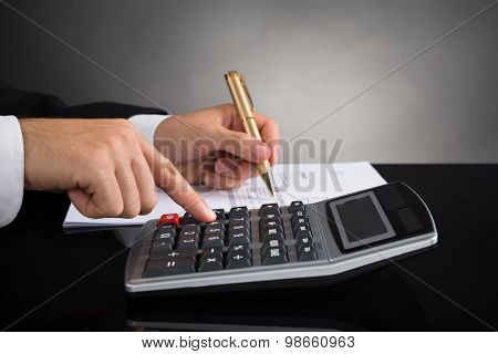 Businessperson Doing Calculation