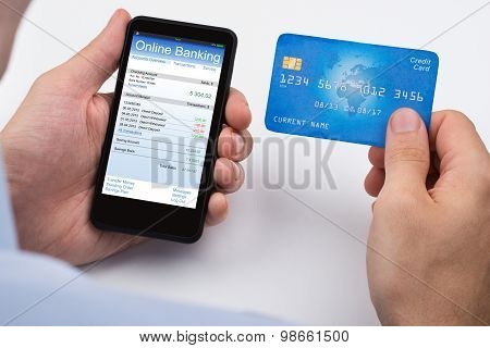 Person With Credit Card And Mobile Phone