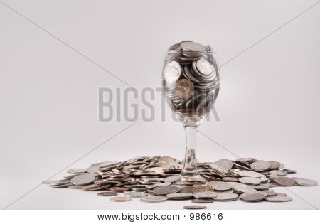 Coins In A Wine Glass