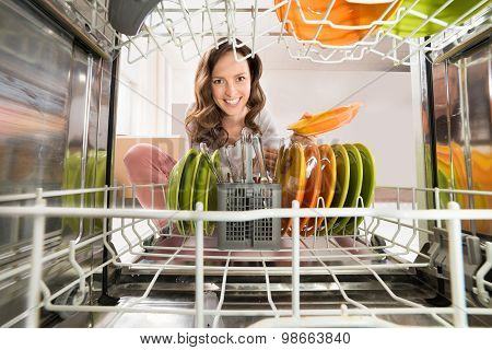 Woman With Plate View From Inside The Dishwasher