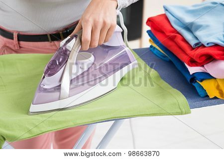 Female Hands Ironing T-shirt