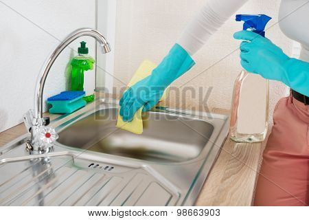 Woman Wiping Kitchen Sink