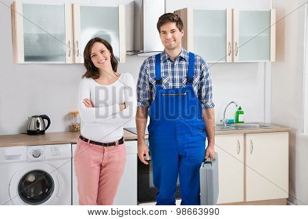 Woman Standing With Repairman