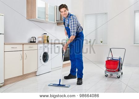 Worker Mopping Floor