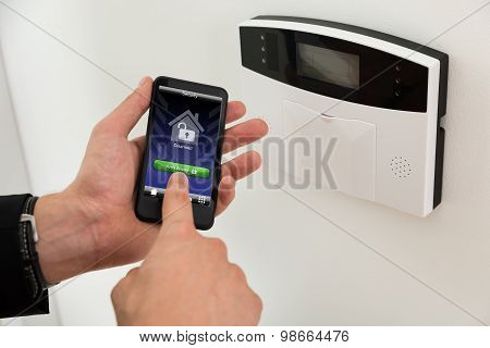 Businessperson Arming Security System