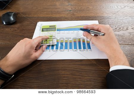 Businessperson Analyzing Statistical Data