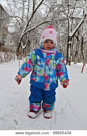 Little Child In Full Growth Against Winter Snow Landscape