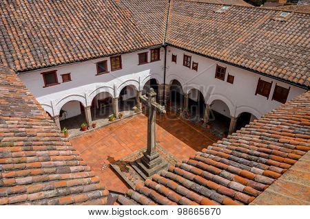 Spectacular shot from San Diego church Quito showing rooftops and backyard of building including pla