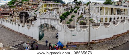 Entrance to San Diego church in Quito shot from inside property above angle showing white stone wall
