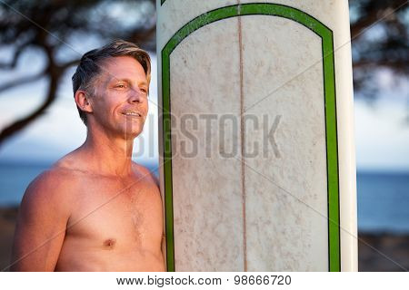 Confident Man With Surfboard