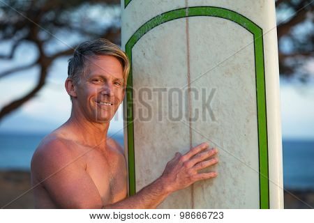 Hopeful Man With Surfboard