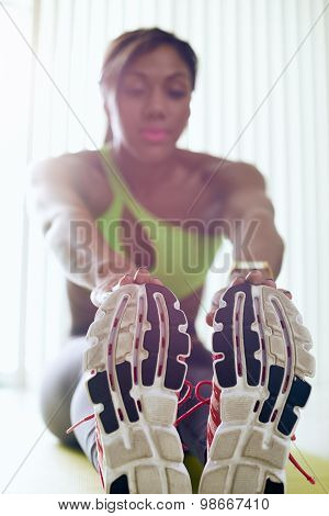 Home Fitness Black Woman Doing Legs Stretching On Pad