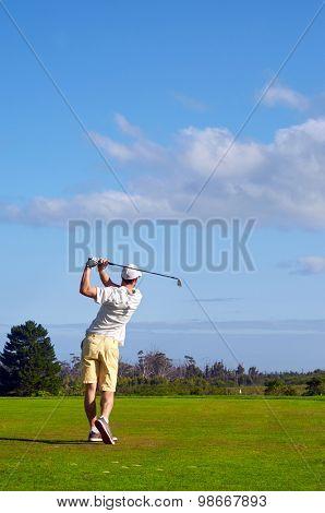 golfer hitting driver off tee box