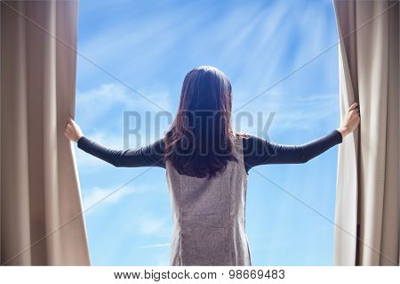 Asian Portrait Beautiful Woman Opening Curtains And Cloud Blue Sky Background
