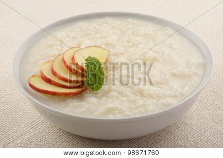 Rice and apple pudding in bowl.