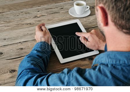Tablet Computer In Men Hands. Man Presses On The Blank Screen Tablet Computer