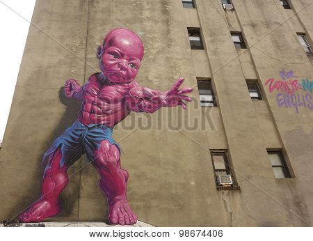 New giant pink Temper Tot mural by Ron English in Little Italy