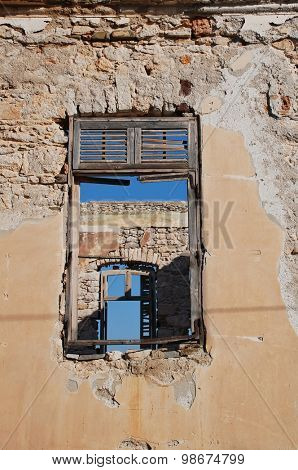Looking through the windows of a derelict building at Emborio on the Greek island of Halki.