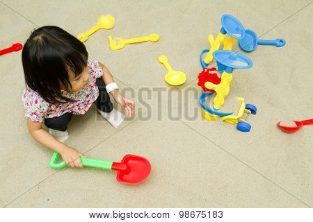 Chinese Children Playing At Indoor Sandbox.