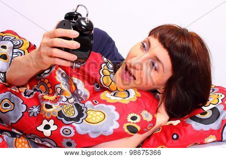 Shocked And Amazed Woman Looking At Ringing Alarm Clock