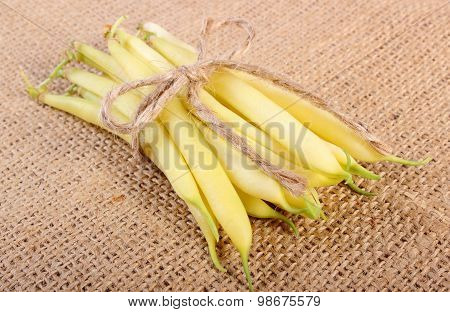 Stack Of Yellow Beans On Jute Canvas, Healthy Food