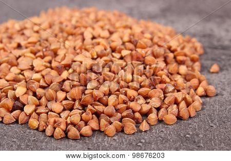 Heap Of Buckwheat Groats On Cement Structure