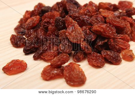 Brown Raisins On Wooden Table, Healthy Eating