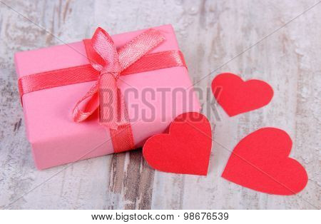 Wrapped Gift For Birthday, Valentine Or Other Celebration And Red Hearts