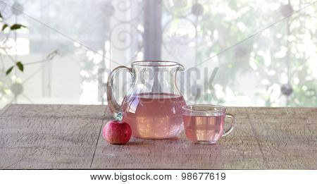 Compote From Fresh Apples In A Transparent Jug On A Wooden Table