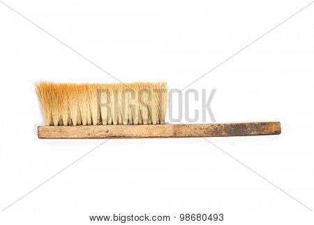 Old broom on white background