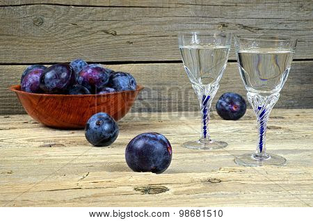 Glasses Of Plum Brandy With Plums