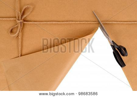 Brown Package With Scissors