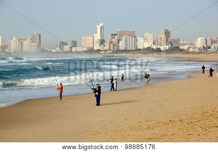 Early Morning Fishermen On Durban Beach With Hotels In Background