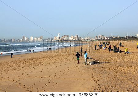Morning Fishermen On Beach With Durban Skyline In Background