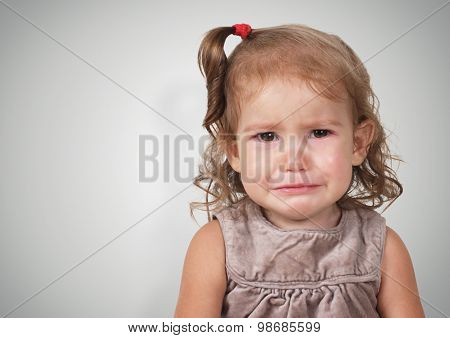 Portrait Of Sad Crying Baby Girl