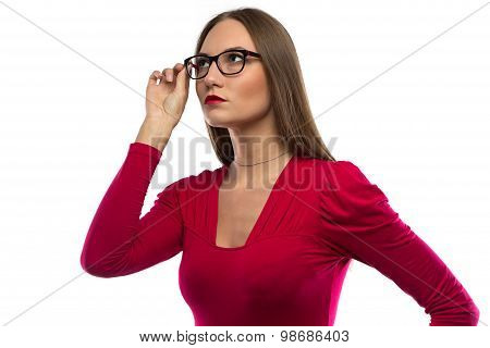 Image of woman in red touching glasses