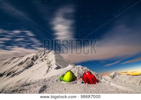 Night Photography of Tents on a Snowy Peak