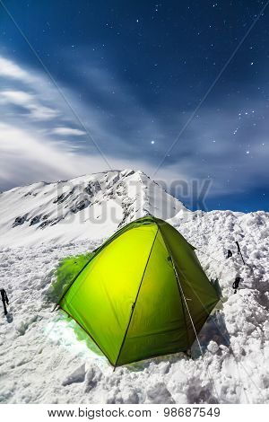 Night Camping on a Snowy Mountain Ridge