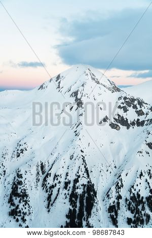 Pyramid Shaped Mountain Peak Covered in Snow
