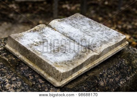 Stony Book Sculpture On The Old Gravestone