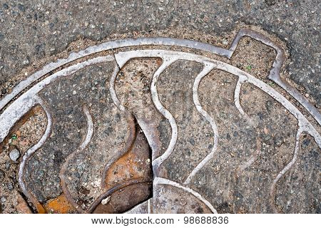 Cracked Metal Manhole Cover