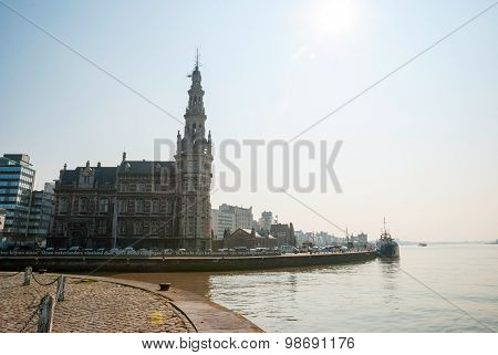 ANTWERP, BELGIUM - MARCH 10: Antwerp and church by the river Scheldt. March 2015