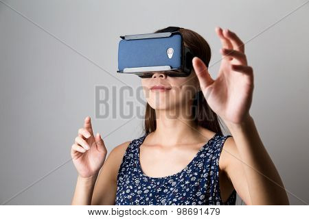 Young Woman using with virtual reality device