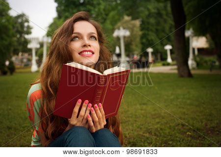 Beautiful Girl With Book In The Park